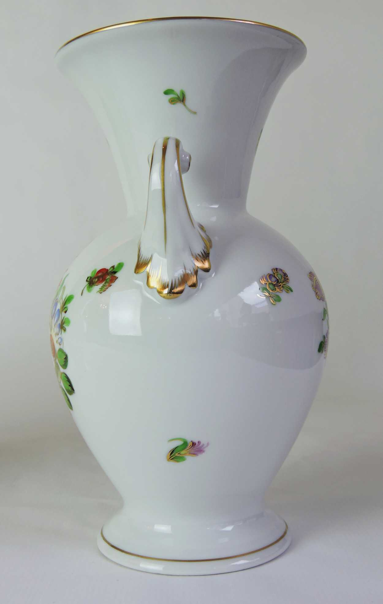 pair of herend porcelain vases with hand