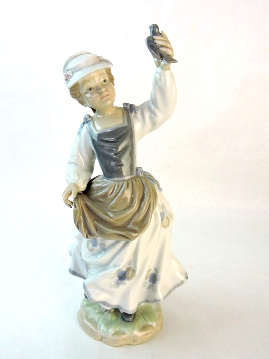 Lladro (Spain) Hand-Made Porcelain Figurine of a Young Woman with Bird